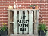 Add storage and interest to your summer gathering place with this easy DIY Pallet Patio Bar.