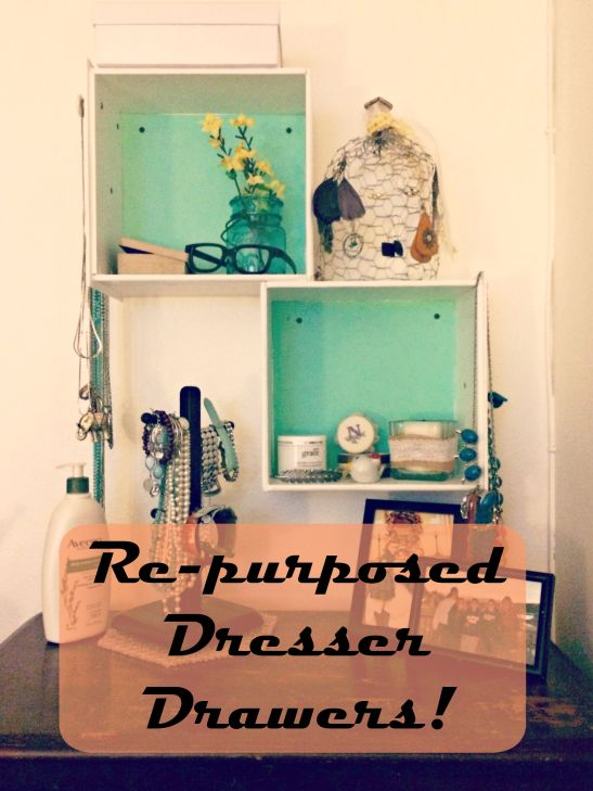 Hang old dresser drawers on a wall for added storage and organization.