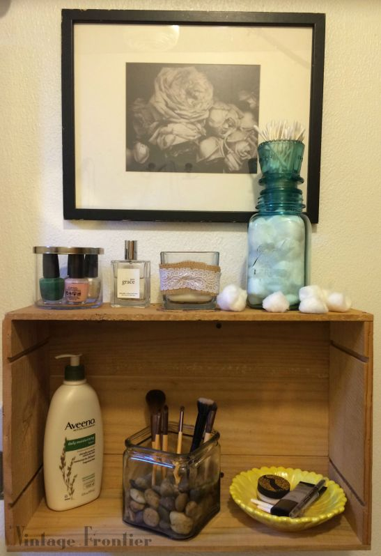 What do you get when you combine a great mason jar and an antique insulator? Amazing Bathroom Storage.