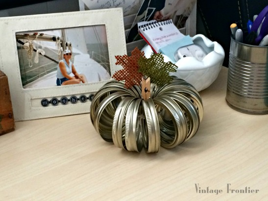 Mason Jar Lids come together quickly to form cute little pumpkins perfect for your fall decor.