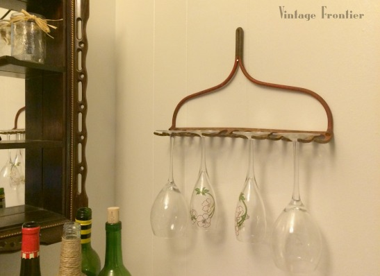 Keep Wine Glasses up and out of the way with an old rake...what could be simpler?